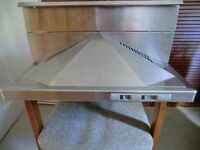 Stainless steel cooker hood.