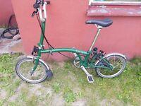 brompton racing bike almost new ,green colour , free pump , free lights