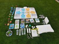 Nintendo Wii Bundle to include Wii Fit Balance Board Games Family Trainer Skylanders Package
