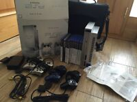 REDUCED -PS2 satin Silver 4 controllers, 10 games, multitap, bag, inc original box and instructions