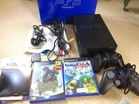 Boxed PlayStation 2 with 2 games, hardly used.
