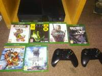 XBOX ONE WITH A MULTITUDE OF GAMES(disc\hardrive) AND TWO CONTROLERS