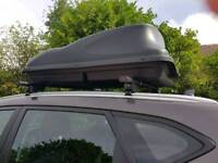 Car roof box with bars.