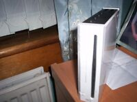 NINTENDO WII CONSOL WITH CONTROLLER AND 9 GAMES