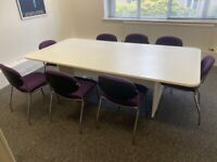 Large white meeting room table