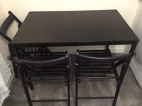 Black IKEA kitchen table and 4 chairs