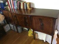 Vintage polished wood sideboard.