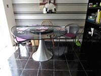 Large Round Black Glass table, 51 inches accross the middle edge to edge