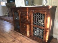 Dark stained wood sideboard