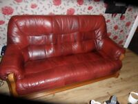 burgundy red leather sofa and one chair
