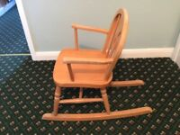 CHILD'S WOODEN ROCKING CHAIR. GOOD CONDITION.