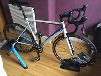 Cycling bike, shoes, t2500 booster turbo trainer and helmet.