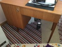 Teak sewing table with machine storage, cupboard and chair