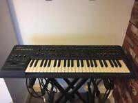Roland JP8000 synth with flight case & power supply.