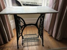 Marble topped table on singer sewing machine base