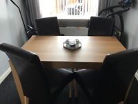 Oak Dining Table with 4 Brown Leather Chairs