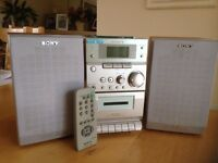 Sony CD, cassette, radio with speakers and remote controller