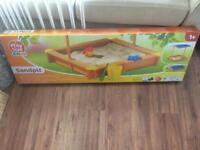 New Sandpit with sun canopy/lid unopened