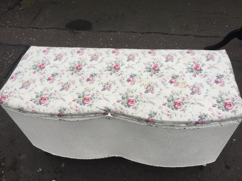 Ottoman Box , covered in floral material . Size L 36in D 15in H 20in .