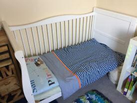 Cot bed with matress, sheets and duvet set.