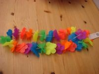 Brand new Flower Garlands, great for fancy dress parties. Very colourful. Can be posted for £1