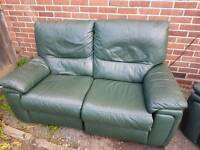 Green electric reclining leather sofa's