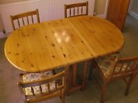 4 piece pine wood dining table and chairs.