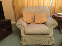 Green three piece suite, two armchairs and sofa