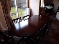 Extending table, 6 chairs 2 of them have arm rests. Some seats still have plastic on them.