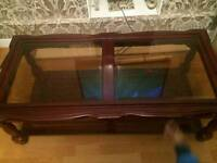 Brown Coffee table with glass top for sale
