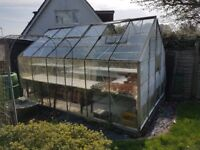 Greenhouse, good condition, with sliding glass door. Shelving units and garden pots etc if wanted
