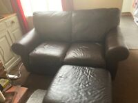 Two sofas and a footstool