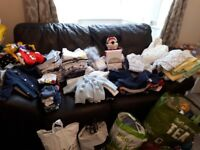 Variety of baby boy clothes from newborn to 6-9 months