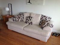 2 x 4 seater cream sofas excellent condition