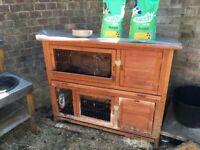 Large animal hutch, 2 floors, rabbit food, water dispenser & bowl.