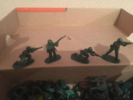 Box of small plastic soldiers