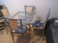 Glass chrome pine wood table and 4 pine wood and chrome chairs