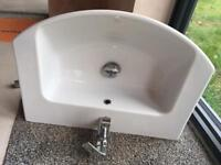 Wall mounted sink with Vado mixer tap
