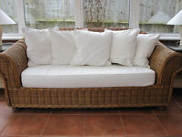 Two 2 seater cane sofa with plain white pads and matching cushions