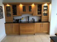 Solid oak door shaker style kitchen with black granite worktops