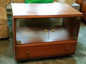 Wood effect tv unit with glass front and drawer