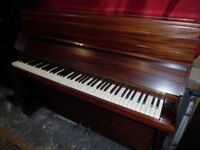 upright piano in a mahogany case