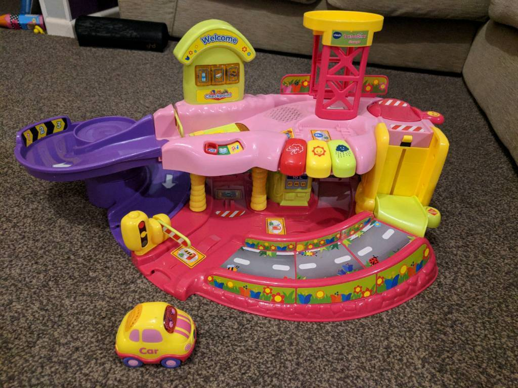 SOLD - Vtech Toot toot garage in pink with 1 car