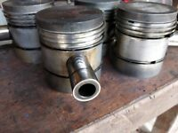 International B275 Pistons x 4 used complete with rings