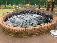 Beautiful Elite bespoke wrought iron pond cover.