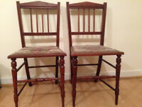 A pair of beautiful wooden chairs