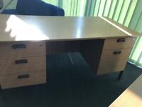 Desk with inbuilt cabinets and swivel chair