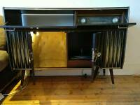 Beautiful vintage record player with radio, dinks cabinet and storage