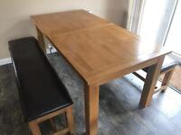 Oak extendable dining table and benches