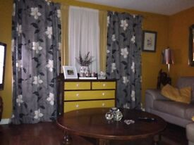 Grey leather corner suite and curtains
